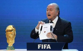 FIFA president Joseph Blatter opens the envelope to reveal that Qatar will host the 2022 World Cup