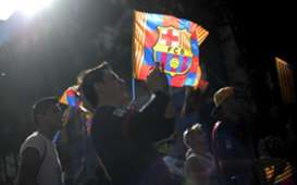 A ray of sun enlightens a flag of FC Barcelona