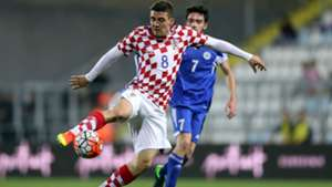 Croatian midfielder Mateo Kovacic controls the ball against San Marino