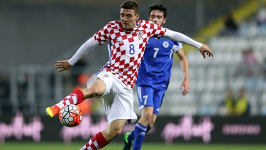 Croatian midfielder Mateo Kovacic controls the ball against San Marino