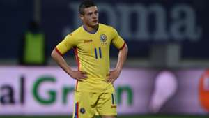 Romania's Gabriel Torje with his hands on his hips