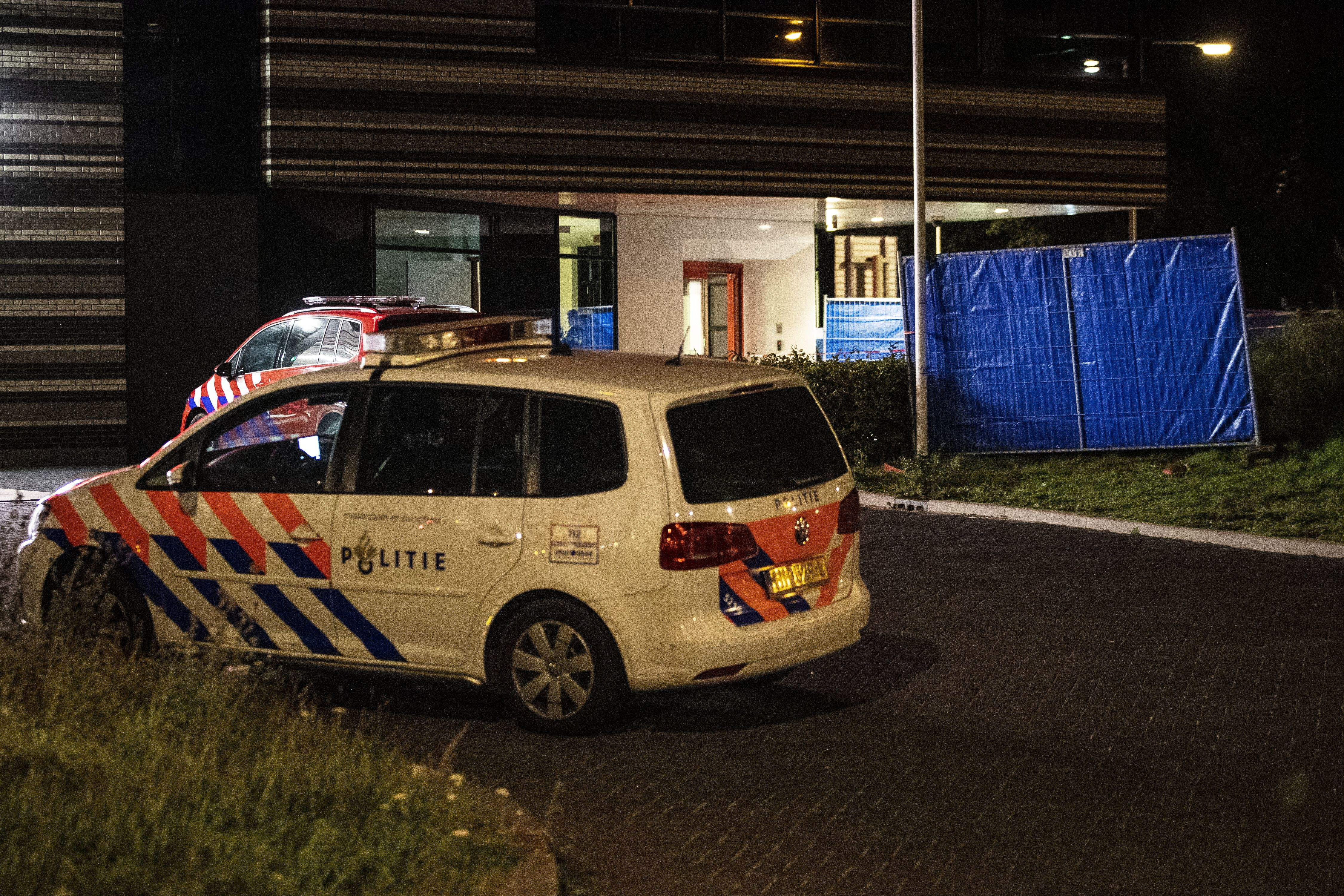 A police car is parked at a fire station in Amsterdam, where a car hit the facade after a shooting 18092019