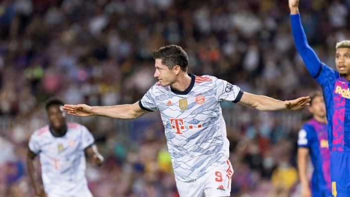 Robert Lewandowski celebrates scoring against Barcelona