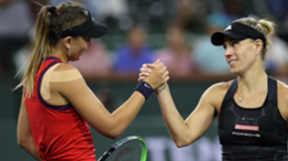 Paula Badosa of Spain shakes hands at the net after her straight sets victory against Angelique Kerber of Germany during their quarterfinal match