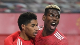 Manchester United team-mates Marcus Rashford (l) and Paul Pogba (r)