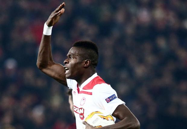 Olympiacos defender Pape Abou Cisse celebrates his goal against AC Milan