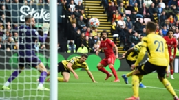 Mohamed Salah (centre) watches his strike find the net for Liverpool