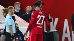 Liverpool manager Jurgen Klopp embraces Divock Origi