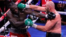 Deontay Wilder feels the force of a right hand from Tyson Fury during their third fight