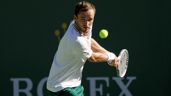 Daniil Medvedev of Russia returns a shot to Grigor Dimitrov of Bulgaria during the BNP Paribas Open at the Indian Wells Tennis Garden