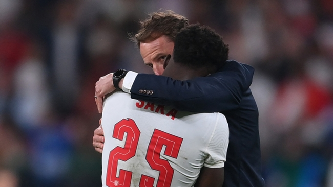 Gareth Southgate consoles Bukayo Saka after the youngster missed his penalty against Italy