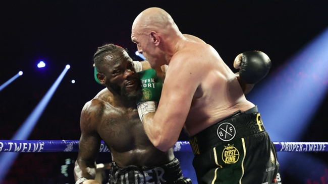 Tyson Fury (right) and Deontay Wilder in action in their second fight