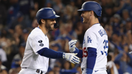 Chris Taylor #3 of the Los Angeles Dodgers is congratulated by Cody Bellinger #35 following a solo home run during the seventh inning of Game Five of the National League Championship Series against the Atlanta Braves