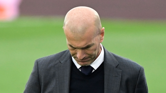 Real Madrid coach Zinedine Zidane bows his head as the LaLiga title goes to Atletico