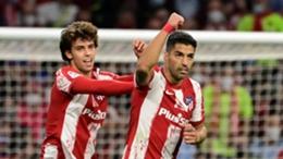 Luis Suarez (r) celebrates with Joao Felix