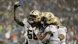 Demario Davis, with arm raised, celebrates a defensive stop