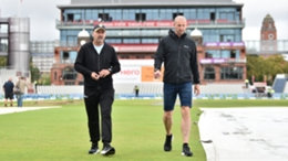 Umpires Richard Illingworth and Michael Gough inspect the pitch at Old Trafford
