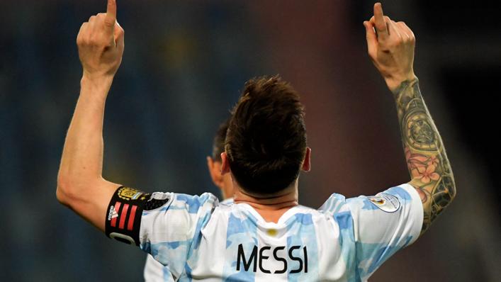 Lionel Messi celebrates scoring for Argentina