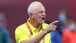 Australia coach Graham Arnold points the way to victory