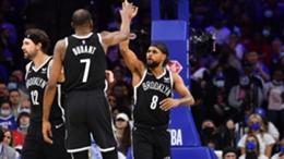 Brooklyn Nets star Kevin Durant (L) and Patty Mills (R)