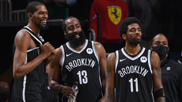 Kevin Durant #7, James Harden #13 and Kyrie Irving #11 of the Brooklyn Nets smile during the game against the Boston Celtics