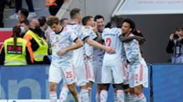 Bayern Munich players celebrate the first of Serge Gnabry's goals