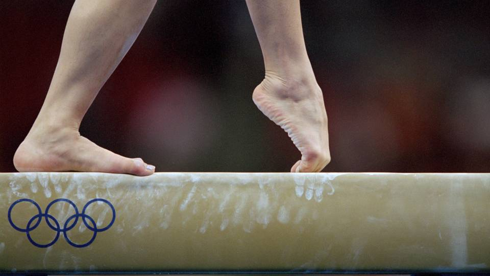 USA Gymnastics settles lawsuit that triggered report of rampant sexual abuse