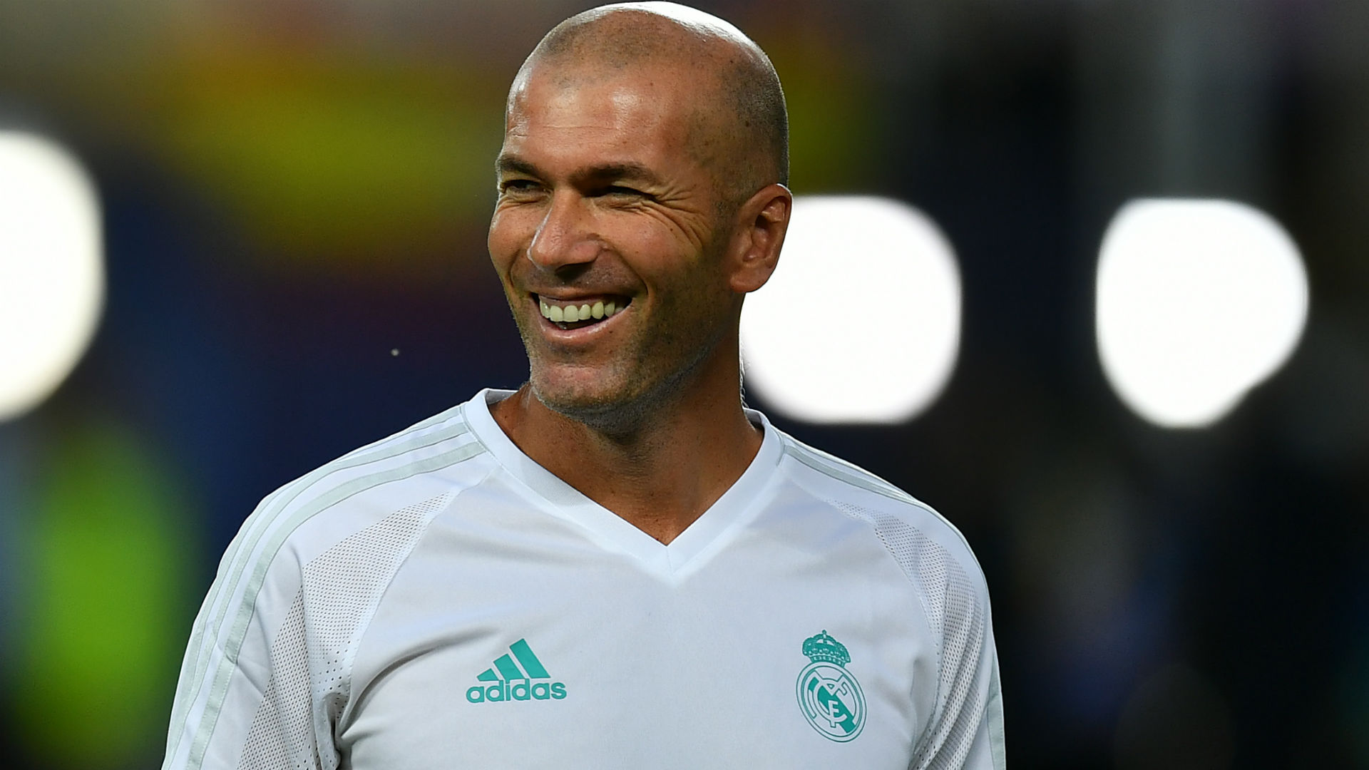 Zidane happy to sign new Real Madrid contract