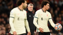 Ole Gunnar Solskjaer (C) presided over a 5-0 home loss to Liverpool