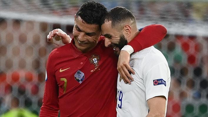 Cristiano Ronaldo and Karim Benzema embrace having scored braces in Budapest.