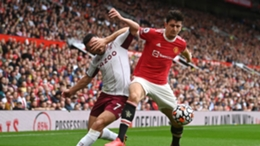 Harry Maguire tussles with John McGinn