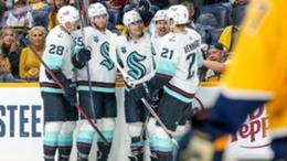 The Seattle Kraken celebrate their first NHL win