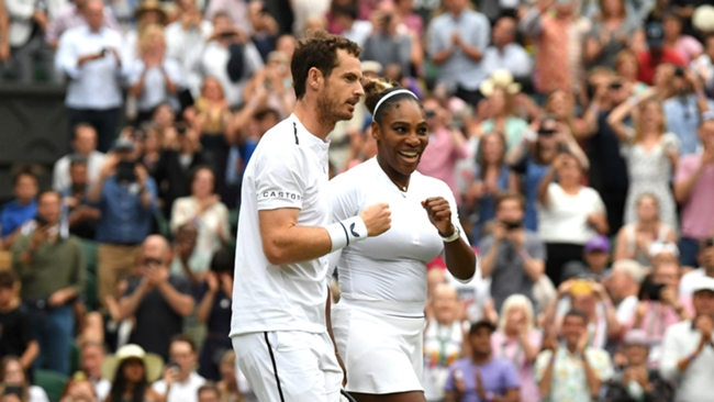 Andy Murray in action with Serena Williams at Wimbledon