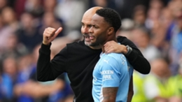 Pep Guardiola and Manchester City winger Raheem Sterling