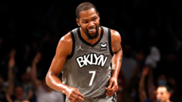 Kevin Durant #7 of the Brooklyn Nets smiles after making a basket during the first half against the Washington Wizards at Barclays Center