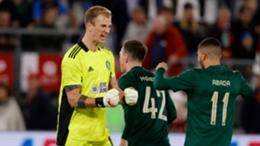 Joe Hart (left) and Liel Abada celebrate Celtic reaching the Europa League group stage
