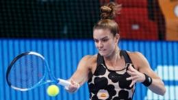 Maria Sakkari hits a forehand against Simona Halep