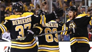 Patrice Bergeron (left), Brad Marchand (middle) and David Pastrnak