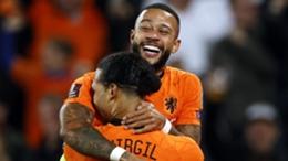 Memphis Depay and Virgil van Dijk celebrate a goal against Gibraltar