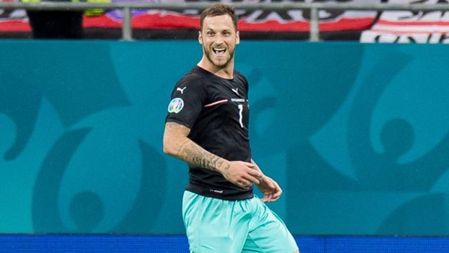 Marko Arnautovic celebrates after scoring for Austria against North Macedonia.