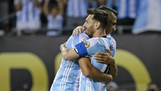 Erik Lamela and Lionel Messi