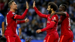 Mohamed Salah (centre) is congratulated after opening the scoring against Porto.