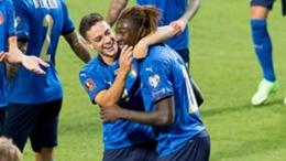 Scorers Giacomo Raspadori (left) and Moise Kean celebrate against Lithuania