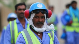 A migrant worker in Qatar on World Cup stadium construction.