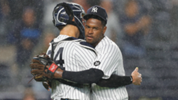 Luis Severino #40 hugs Gary Sanchez #24 of the New York Yankees after the ninth inning against the Texas Rangers at Yankee Stadium