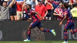 Shaq Moore runs away from team-mates as he celebrates