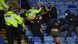 Police try to hold back Napoli fans