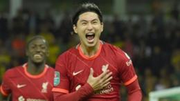 Takumino Minamino celebrates as Liverpool beat Norwich