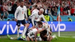 England players celebrate Harry Kane's decisive goal against Denmark