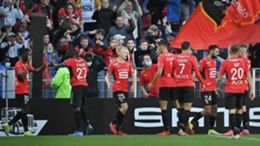 Rennes' players celebrate after scoring against PSG